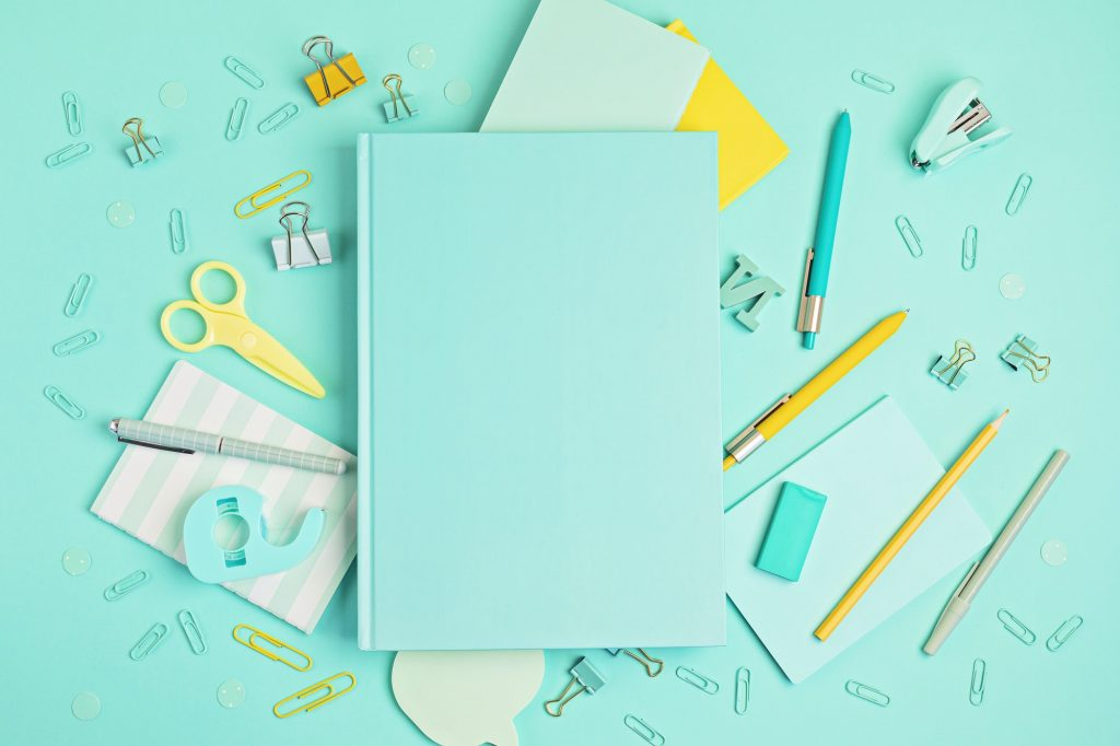 Back to school concept. School and office supplies on pastel background. Education, preparation to