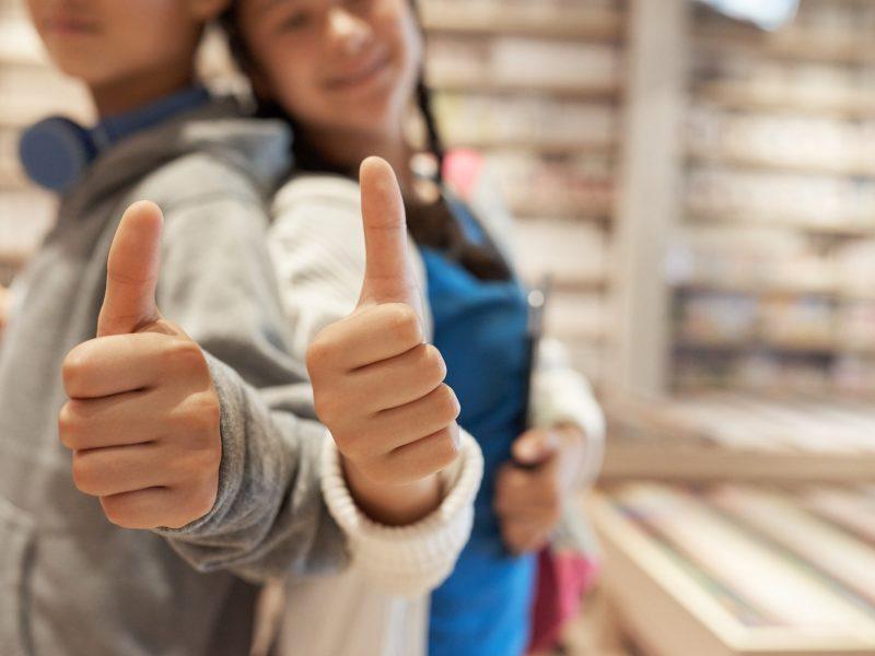 School kids giving thumbs up